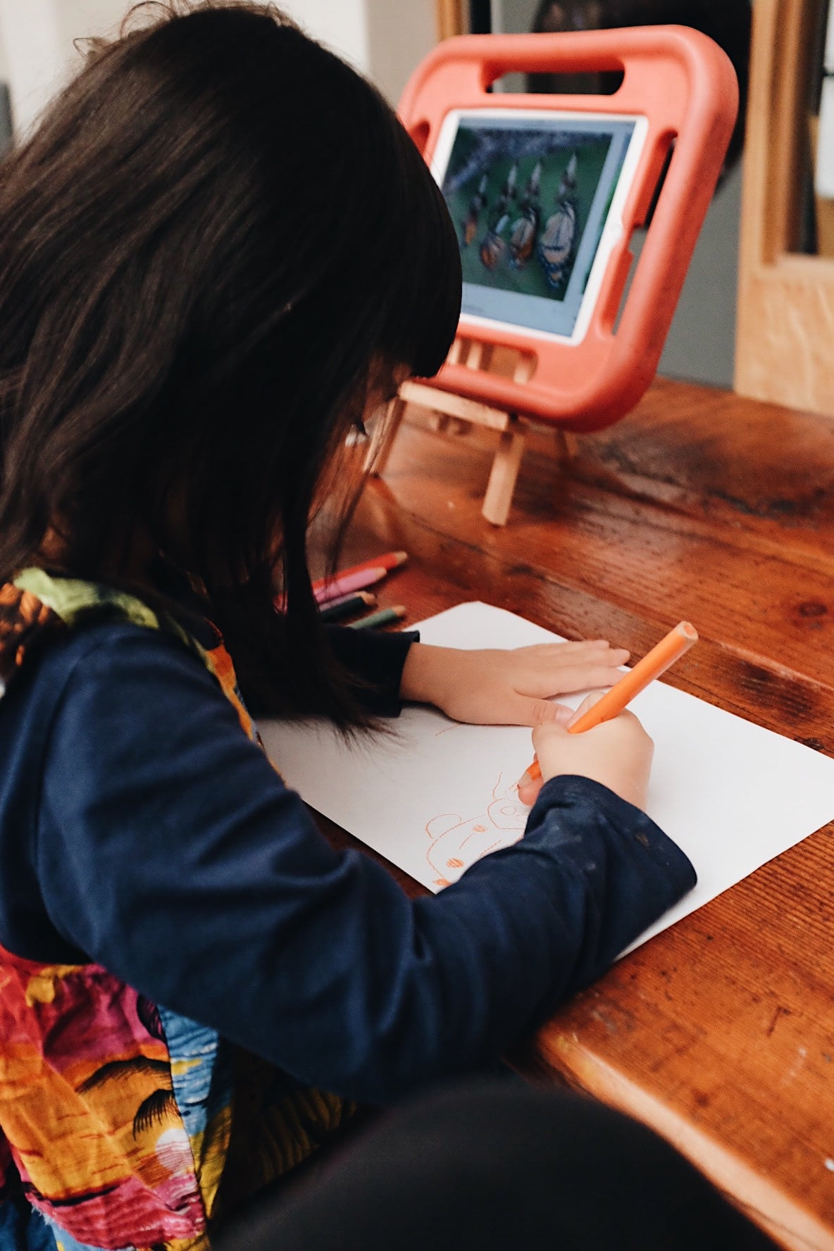 ExploreDevelop Camperdown Childcare A Child writing